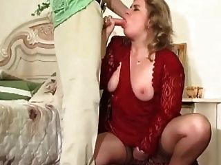Horny Milf In Stockings Calls A Young Boy For Some Action